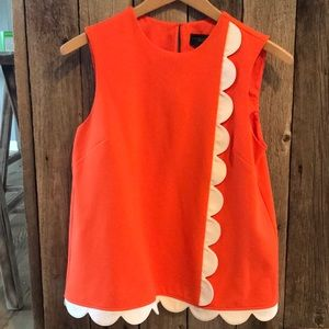 Victoria Beckham orange sleeveless shirt